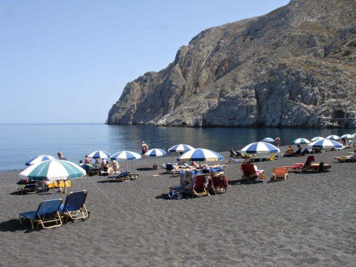Black beach in Kamari, Santorini, Greece holidays
