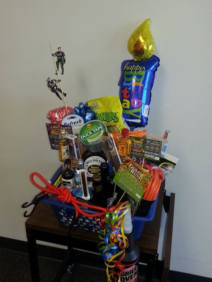 """I made this for my boyfriend for his birthday. It is manly """"bouquet""""! I am throwing him a Birthday Cookout and this will be the centerpiece. I bought all kinds of snacks, cigars, one shooters, lotto tickets, local beer, manly tools, bbq gear, some birthday decor, and even a couple GI Joes. I used a glue stick and tape to tape them all to bamboo skewer sticks, stuffed beer, red bulls on the bottom of the basket as a foundation and then arranged the sticks in a creative way."""