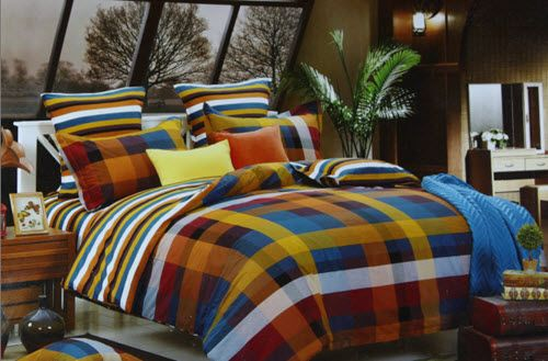 Perfect example of elegance and classiness, this Coordinated pattern Bed Linen Set in carefully selected Blue, Brown and Mustard Checks will give an Elegant look to your Bedroom.This Set in fine quality Cotton fabric of Size 275*275cm is perfect for Queen or King size Beds. It will truly add a unique charm to your Bedroom and co-ordinate well with all Interior types.The contrast Pillow cases is yet another feature that make this product even more exotic and classy.