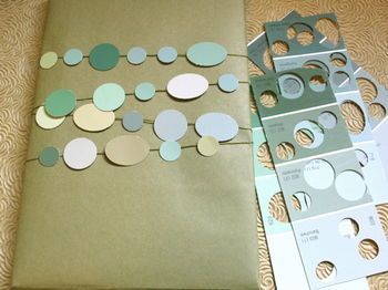 Punch shapes out of paint swatches to make a color-coordinated garland.