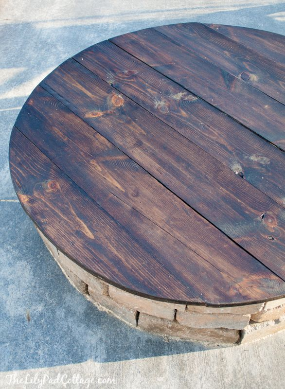 DIY Fire Pit Table Top - The Lilypad Cottage...you can also just take the base off of a round dining room table or take one side off of the large cable spools if you want to make one of these very easily. Cheap second-hand round tables & cable spools can be found cheaply on craigslist/thrift stores.