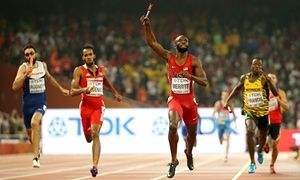 Lashawn Merritt crosses the line to win gold for the United States, ahead of Great Britain's Martyn Rooney, Trinidad and Tobago's Machel Cedenio and Javon Francis from Jamaica.