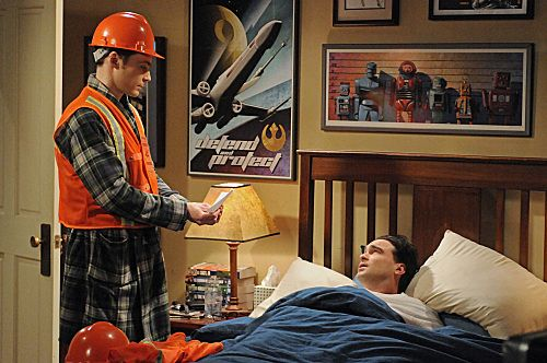 """The hardhats that Sheldon prepares for the emergency preparedness drill have miniature apartment flags on them. Sheldon's safety vest has the words """"Apartment 4A Warden"""" on it."""