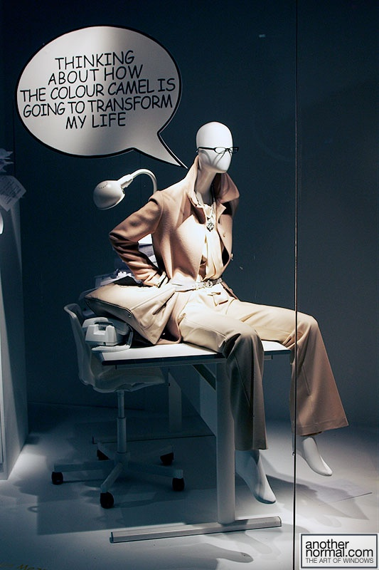 this window display makes a BIG impact - a mannequin, signage and a creative use of foam core. Find mannequins at MannequinMadness.com