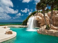 Tropical Swimming Pool with exterior tile floors, Pathway, Fountain