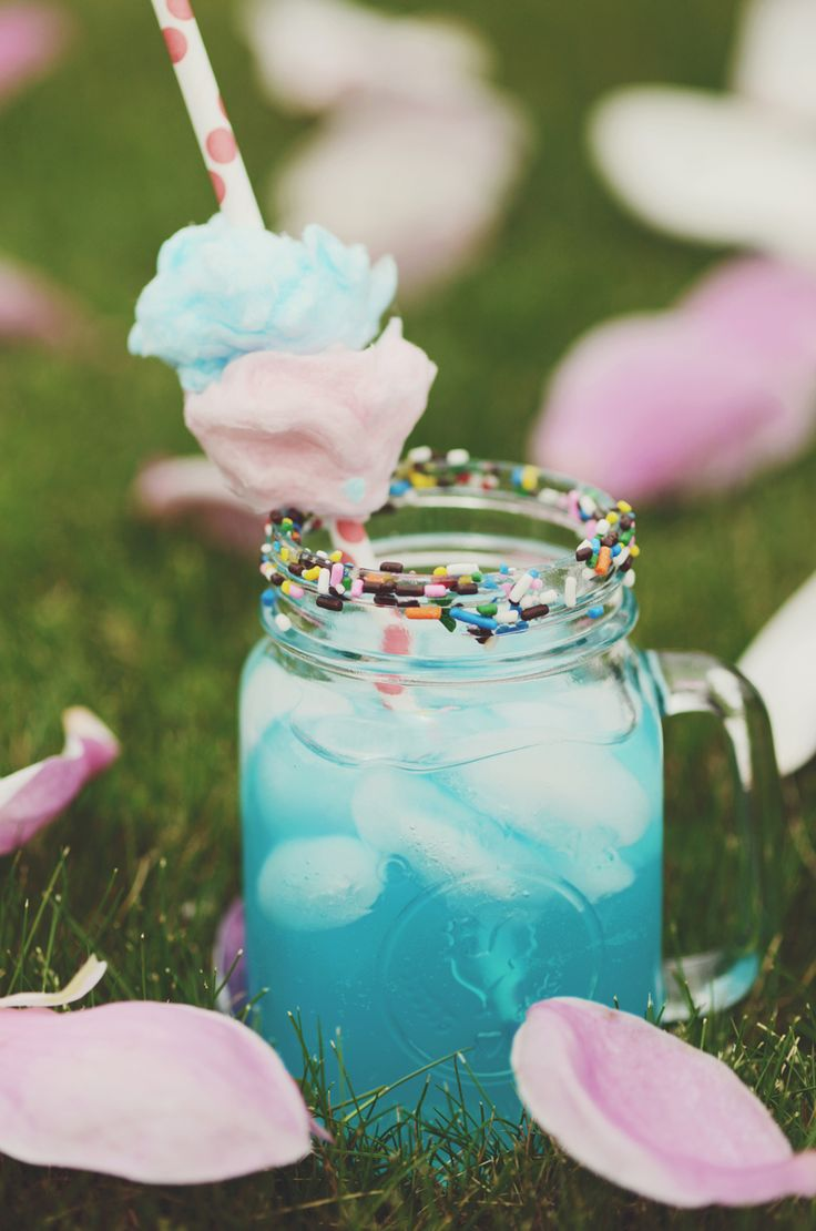 How about a Cotton Candy Margarita?! It's definitely a fun twist to the traditional drink! Add some sweet puffs of cotton candy and sprinkles to garnish! Perfect for a girls night or party!