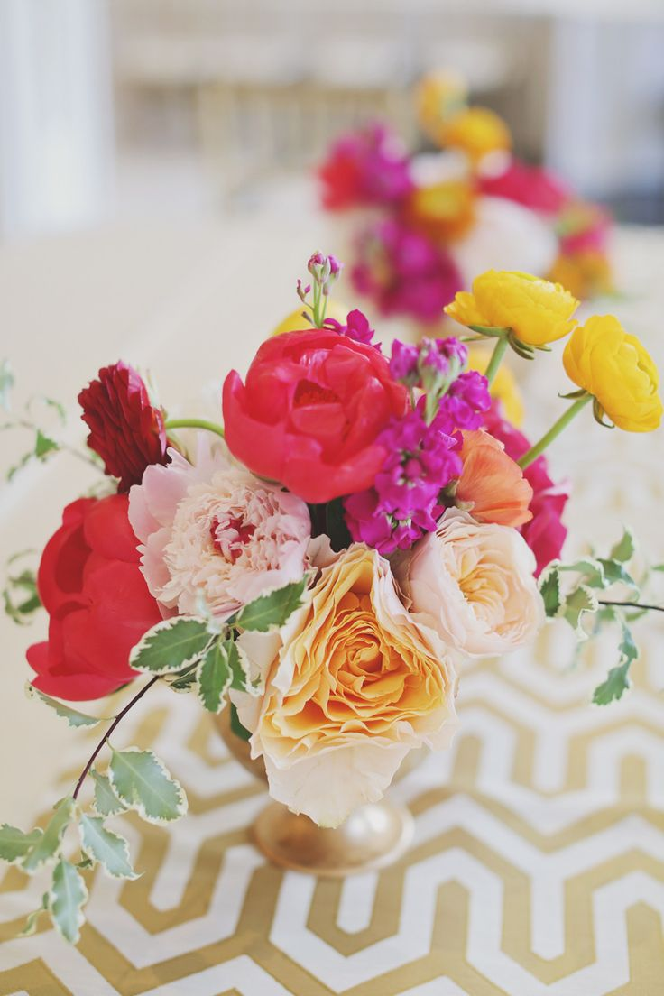 Gorgeous Colors in this wedding! #Centerpiece   Forever Photography Studio   See more on SMP - http://www.StyleMePretty.com/2014/01/06/colorful-chateau-cocomar-wedding/