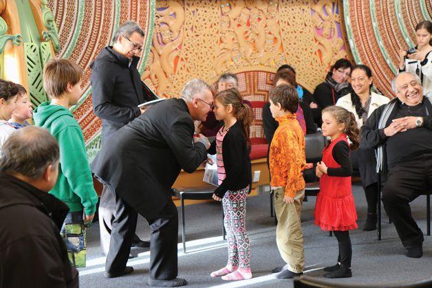 This is a big day for Bubba Thompson (Waitaha, Kāti Mamoe, Kāi Tahu, Ngāti Kahungunu ki Wairoa) from Te Rau Aroha Marae. Today he will present four story books to the school children. The books tell stories which are also told in the whakairo at the marae. Stories of Ngāi Tahu tūpuna unique to this area.