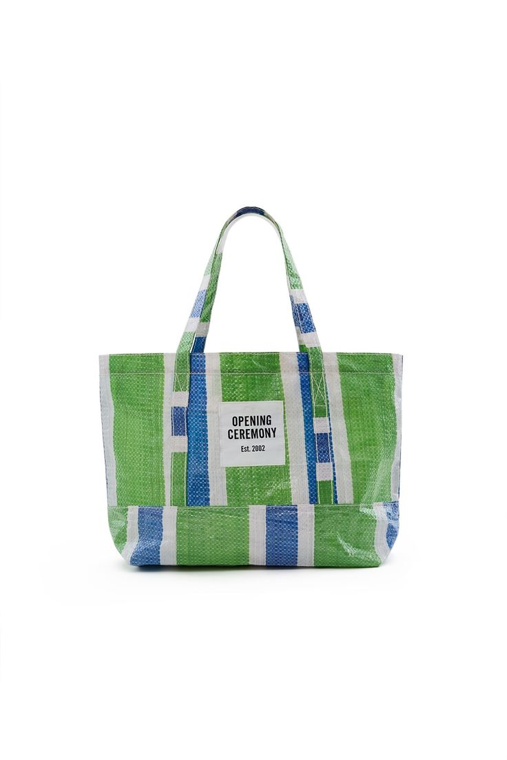 Opening Ceremony, Small Striped Tote Bag OC's thermoplastic shopping totes first appeared during 2016's Year of China. This Spring/Summer 2018, Torch updates OC's signature bags in sturdy but lightweight striped tarp material. Available in blue, green, and red multi., OC EXCLUSIVE, Top handles, Top zipper closure, OC logo patch, 100% PVC, Imported
