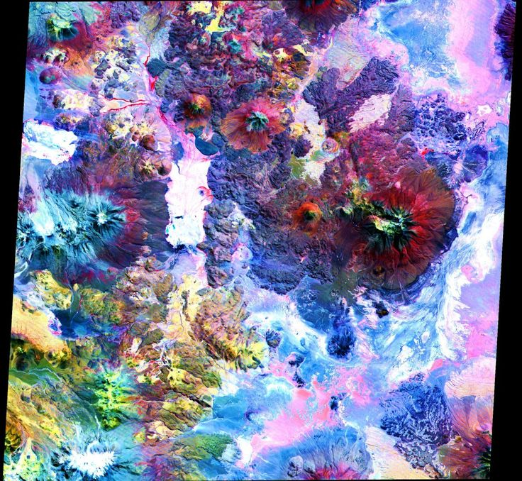 Many ASTER images look like they were colored in by a little kid, including this one of the Andes Mountains. But that's because it has an infrared camera that can detect changes in surface temperatures, materials, and elevation.