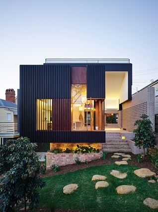 The cantilevered form of the dining room allows for access to a basement garage and a visual connection between the street and rear garden.