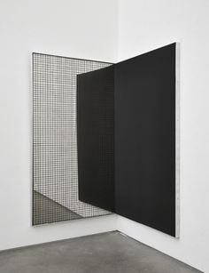 square shape in black & reflective panel with mesh grid overlay