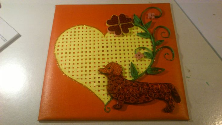 I braided a yellow heart of paper. Everything else is made of Paper Quilling: heart flower and a dachshound. -Louise Mirabilis