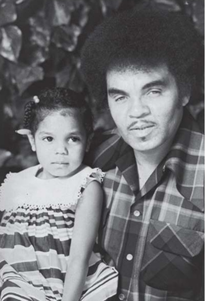 Young Janet Jackson with her dad Joe Jackson