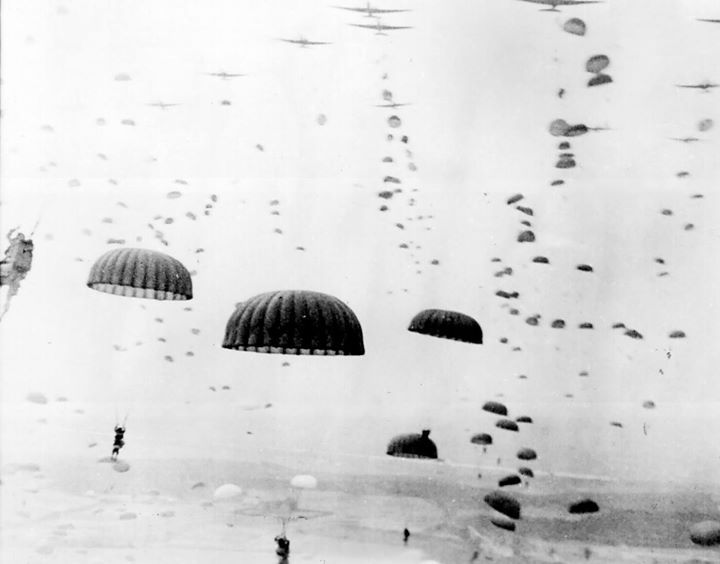 Parachutes open as waves of paratroops land in Holland during operations by the 1st Allied Airborne Army in September of 1944. Operation Market Garden was the largest airborne operation in history with some 15000 troops were landing by glider and another 20000 by parachute.