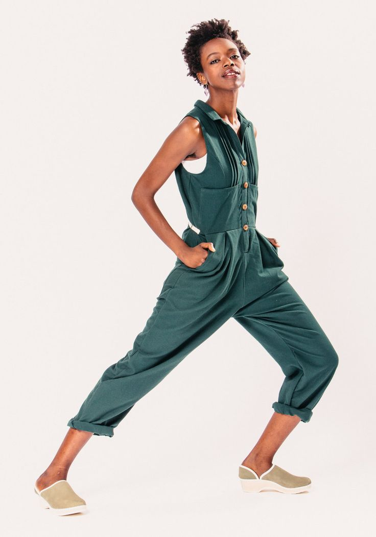 The Wilson Coveralls are handmade by Rebe from a forest green cotton. This fitted garment is an interpretation of the working man's overalls. It features four pockets in front and two in back, a collar, bamboo buttons, pin tuck detailing at shoulder, and a natural cotton twill tape adjustable
