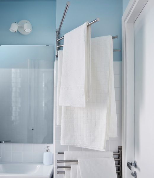 Looking for big storage in a small bathroom? One tip is to use your room's odd spaces like this towel rack that fits on the corner and behind the door.