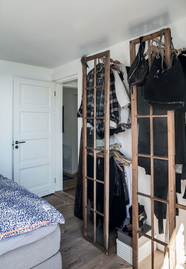 Rustic and decorative wardrobe storage solution in the bedroom.