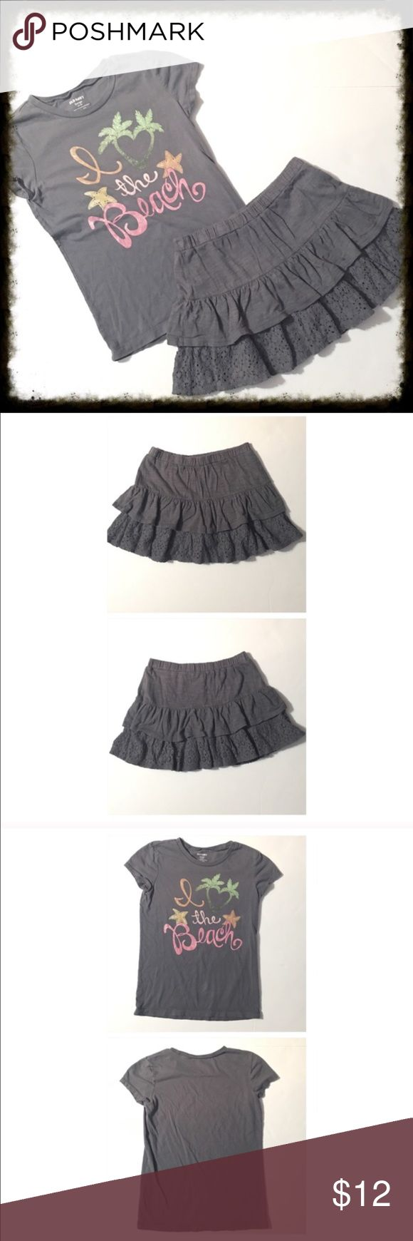 "Girl's Old Navy Skort & Tee Set Size 10/12 Gray skort and gray ""I Love the Beach"" tee are from Old Navy. Both are size 10/12. In good condition. Skort has attached shorts underneath. Matching outfit. Old Navy Matching Sets"