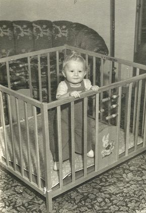 Old wooden playpen.....they may be considered unsafe today but they were so much better looking...not so 'industrial' as todays folding metal and plastic ones.