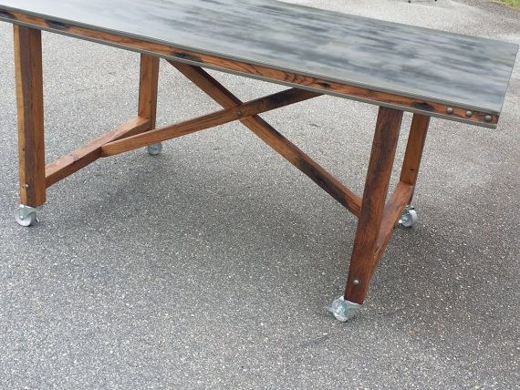 This reclaimed oak and cool grey steel rolling island, or dining table, is a super functional and multipurpose dining/prep/work space. The locking casters make it both mobile and stable. This one of a kind island or dining table will be made just for your space. This listing is for a 3x8 size dining table... BUT, the specific measurements are up to you, and the price will change accordingly -- make it bar height, counter height, super deep or narrow, whatever you need for your space...