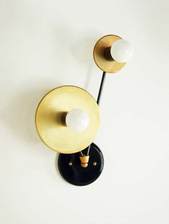 This Mid Century double brass wall sconce is a unique design piece handmade and handcrafted in our studio with sustainable materials. An elegant addition to your space that provides light where you need it. It will make a great center piece for your modern home or traditional decor. As well, it will add lovely charm to your bedroom, foyer or home office, dining room or restaurant, bar. This lamp is hard wire, professional installation recommended. All electrical components are UL listed…