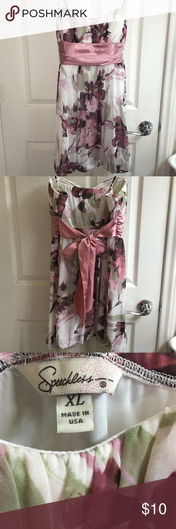 Formal Floral Dress. Sz: XL Excellent condition, no loose threads/stains/tears. Adjustable (non-removable) straps. Lightly padded. Junior's XL so can fit Women's M-L. Sheer floral outer layer, sewn at the bottom to an opaque cream inner layer. Satin tie-back bow (non-removable). Bought from Macy's. Brand is Speechless. Dresses Mini