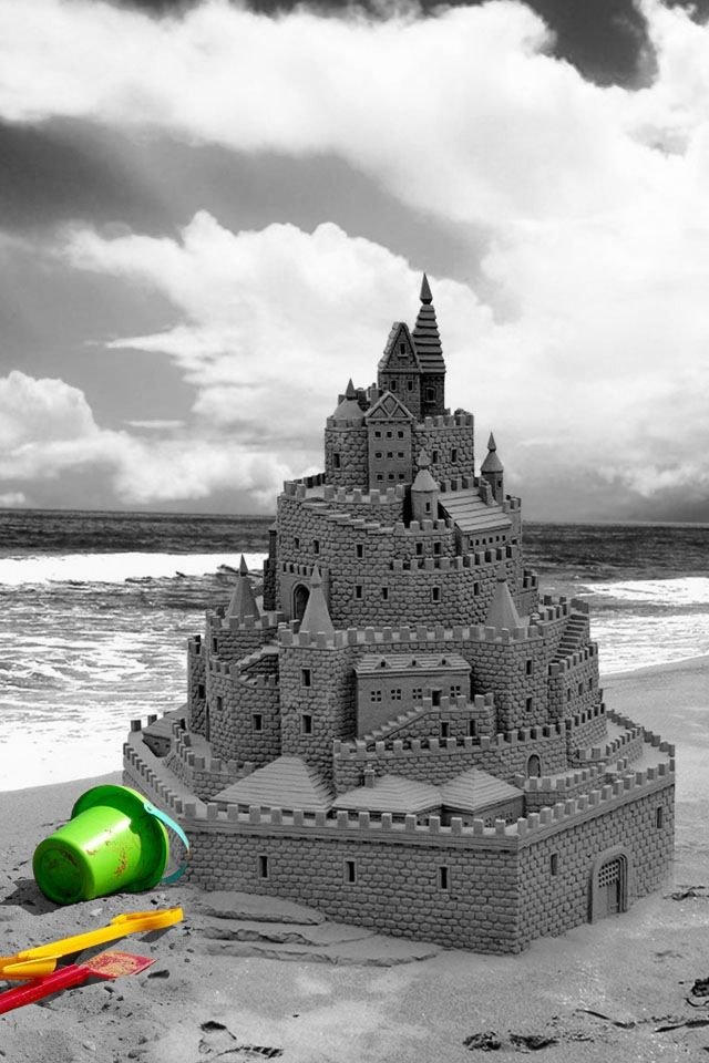 Making sand castles. . .now, this one looks like I MIGHT be able to build similar.  I think they might  be sneaking some clay or cement in there.  .  .  .  photo credit:  unknown