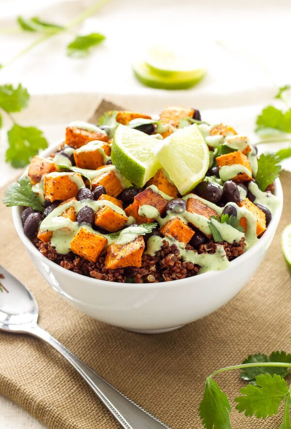 Healthy Sweet Potato and Black Bean Quinoa Bowl with fresh Cilantro Cream Drizzle!  To veganize use plain vegan yogurt and sweetener of choice.