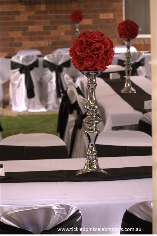 Candelabra centrepiece with red or white rose ball available for hire