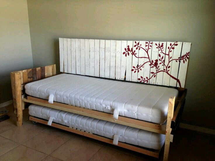 Daybed with an extra sleeping place, made from pallets.                                                                                                                                                                                 More