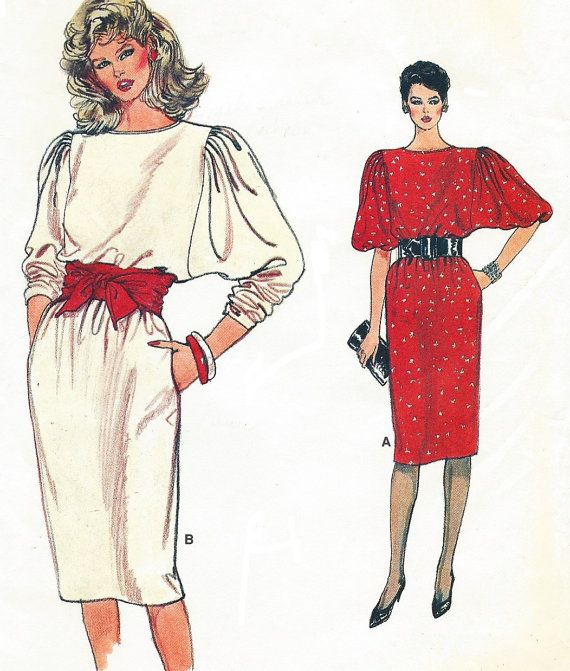 Misses Dress: Loose-fitting, straight, pullover dress, below mid-knee, has back neckline slit with button/loop, side pockets and above elbow length