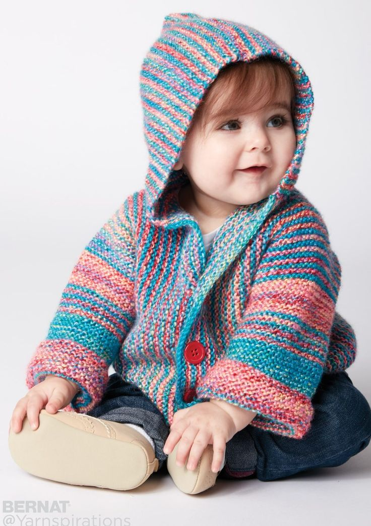 Free Knitting Pattern for Show Your Stripes Baby Jacket - This easy hooded baby jacket is knit in garter stitch. The sweater is knit in one piece from side to side and the stitches are picked up to knit the hood. Sizes 6 and 12 months