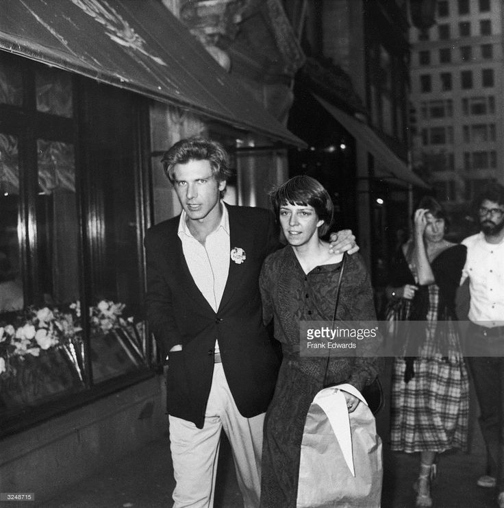 1977: American actor Harrison Ford and wife, Mary Marquardt, walking in New York City. Filmmaker George Lucas and wife, Marcia, walk behind them.