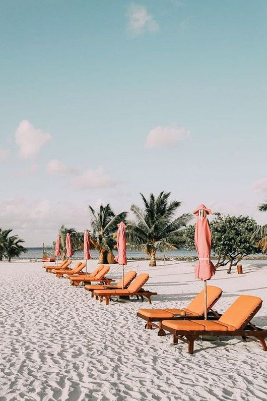 sandy beach with pink and orange furniture. / sfgirlbybay
