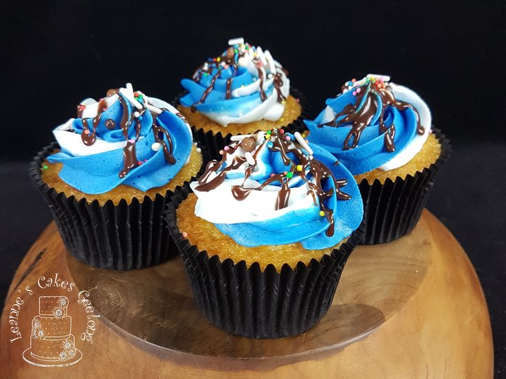 Vanilla cupcakes with buttercream frosting and a chocolate drip with sprinkles. www.facebook.com/cakesbyleannerhodes