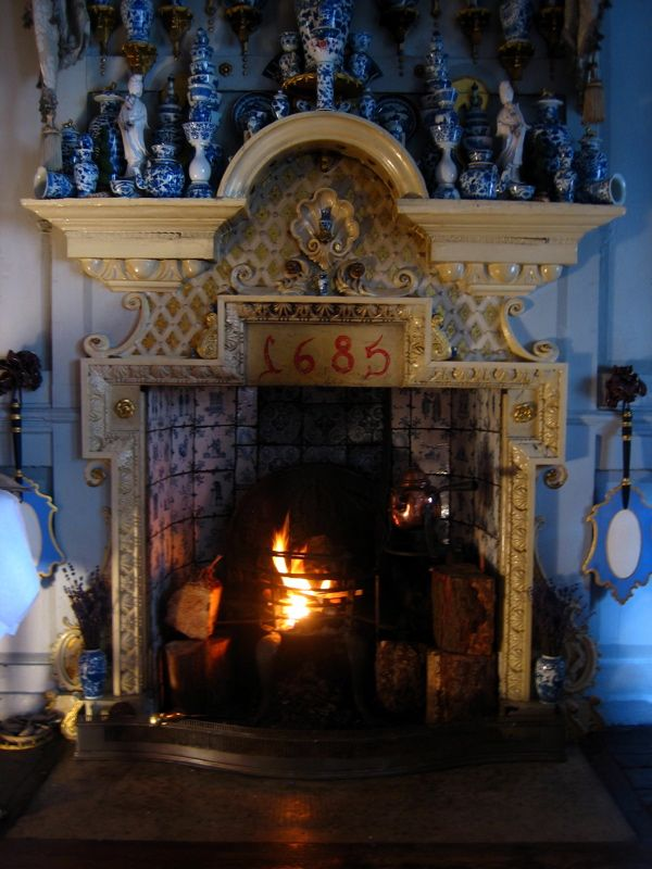 Simon Pettet's faux Delft tiles in a fireplace at the Dennis Severs' House