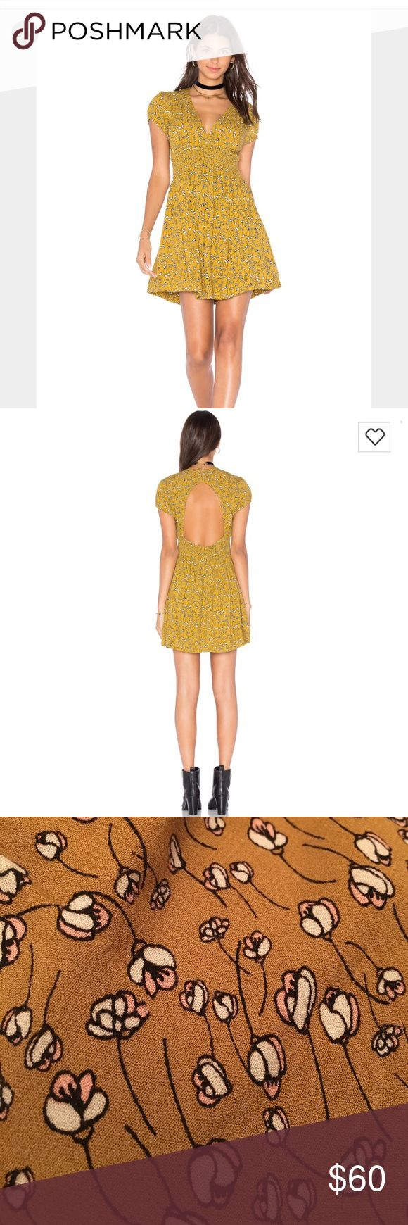 """🌷🌿Beautiful Free People Floral dress 🌿🌱 ⭐️Beautiful Free People mustard colored Floral dress.. elastic band gives definition to ur waist, and cut out on back gives this dress extra flare and makes this the perfect spring and summer dress⭐️🌱.. New w tags . Make an offer ⭐️🌿 size chart included .. shoulder to bottom hem is  approx 33"""" 🌿⭐️🌈 Free People Dresses Mini"""