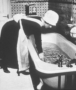 Parlourmaid preparing a Bath Before Dinner, Bill Brandt, 1939 © Bill Brandt Archive Ltd.
