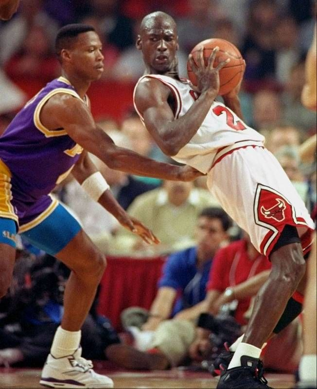 Los Angeles Laker guard Byron Scott, left, checks Michael Jordan during the third quarter of Game 2 of the #NBA Finals in Chicago. #MJ