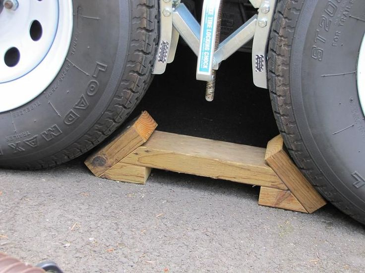 "A pair of chocks that are sturdy and can be thrown down in an instant. They fit between the tires with about ½"" to spare. The best part is that they can't flip up out of the way if a tire rolls onto them."