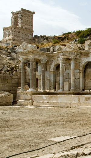 The Antonine Nymphaeum (foreground), a monumental fountain located on the north side of the ancient city of Sagalassos, was built during the reign of Marcus Aurelius (A.D. 161–180) and was one of the most elaborate structures of the city. Photo: Danny Veys   Archaeological Discoveries at Sagalassos (Visit the Getty)