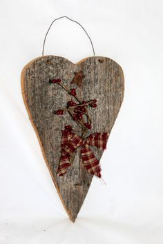 Barnboard heart with pip berries, small rusty star, tied together with a homespun bow.  Perfect for Valentine's Day decoration!