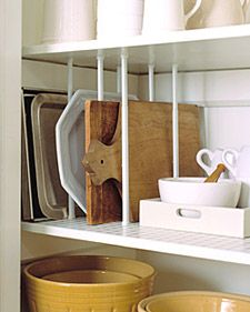 Create more space in your kitchen with these clever tips and tricks.: Kitchens, Cutting Boards, Ideas, Kitchen Organization, Cuttingboard, Curtain Rods, Storage Idea, Tension Rods