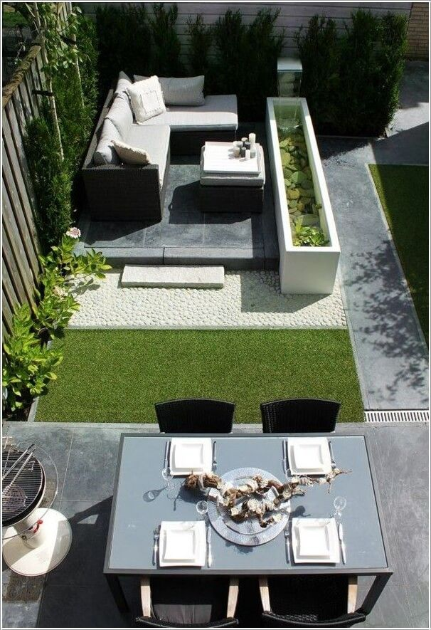 15 Totally Unique Ways to Design Your Courtyard - Design a Sitting Space with a Water Feature Accompanied by a Dining Area