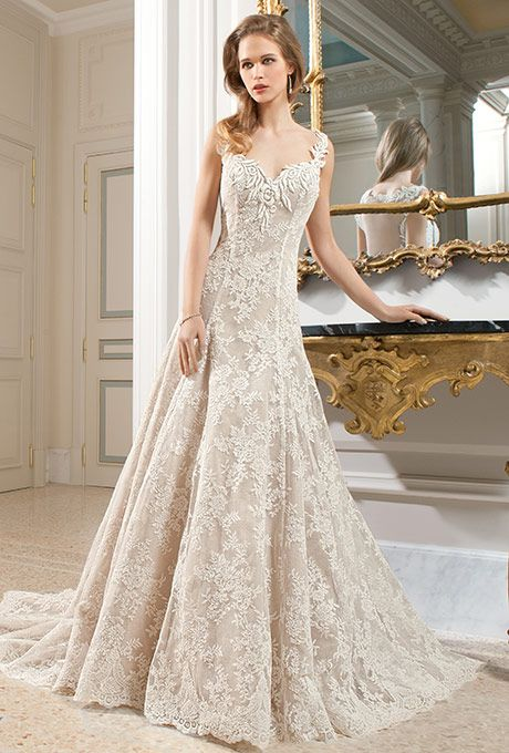 Brides: Demetrios - Couture. This all lace a-line gown features a unique design of flower embroidery on the v-neckline and straps transitioning into a dramatic, low keyhole back. Delicate venise lace embellishes entire gown and chapel train.