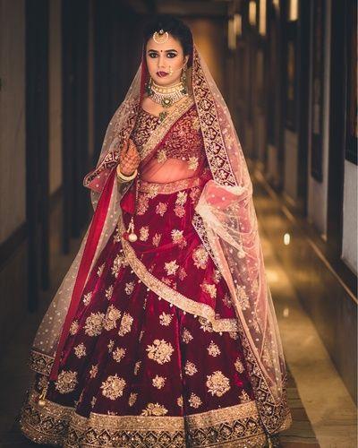 Bridal Wear - Marsala Velvet Lehenga with Golden Embroidery | WedMeGood #wedmegood #bridalwear #indianbride #marsala #gold #indianwear #lehenga