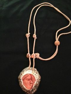 Limpet shell with porcelaine glaze and adjustable leather thong medallion with wooden bead detail