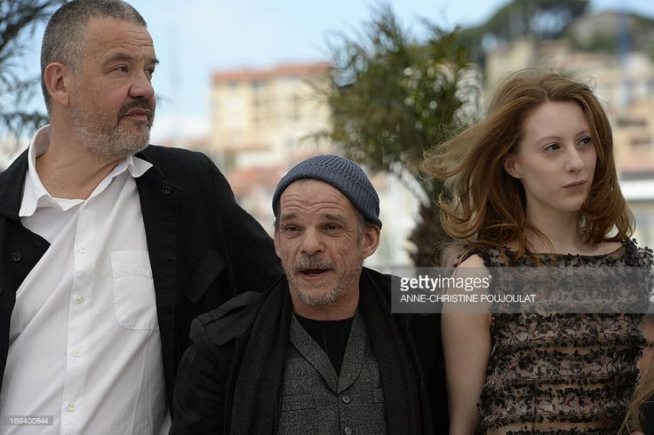 French director Arnaud des Pallieres, French actor Denis Lavant and French-Austrian actress Roxane Duran pose on May 24, 2013 during a photocall for the film 'Michael Kohlhaas' presented in Competition at the 66th edition of the Cannes Film Festival in Cannes. Cannes, one of the world's top film festivals, opened on May 15 and will climax on May 26 with awards selected by a jury headed this year by Hollywood legend Steven Spielberg.