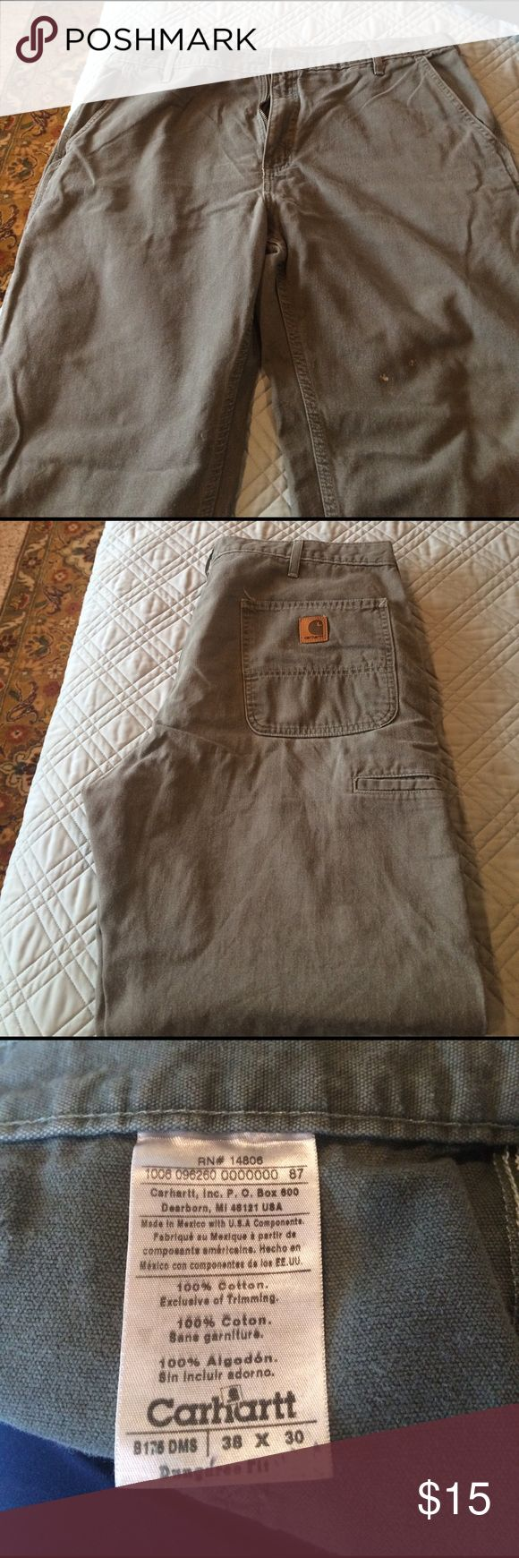 Men's Carhartt Pants Great condition.  38x30.  They just don't fit him ; ).  Two small white spots on front leg.  See first pic.  These are really heavy duty pants for outdoor activities.  Color is hard to explain. Kinda light light army green. Carhartt Pants
